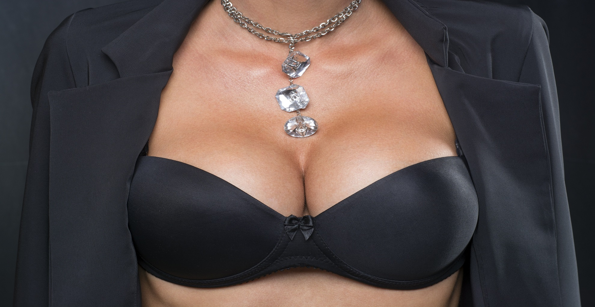 Big Breasts Lady In Sexy Corset and necklace jewelry